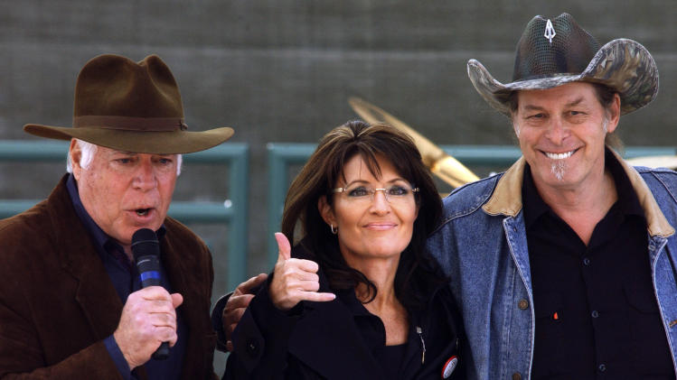Republican candidate for Senate, John Raese, left, Sarah Palin, center, and performer Ted Nugent embrace during a rally in Charleston, W.Va., on Saturday, Oct. 30, 2010. (AP Photo/Jon C. Hancock)