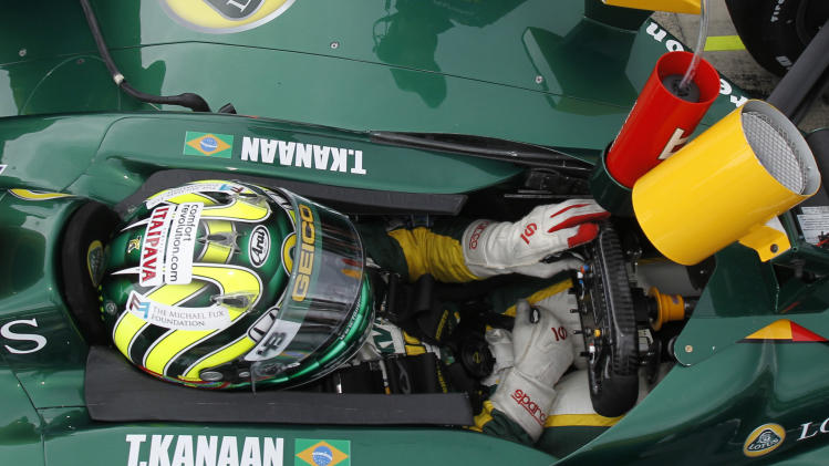 Tony Kanaan, of Brazil, sits ih his car during a break in practice for the Indianapolis 500 auto race at the Indianapolis Motor Speedway in Indianapolis, Saturday, May 14, 2011. (AP Photo/Darron Cummings)