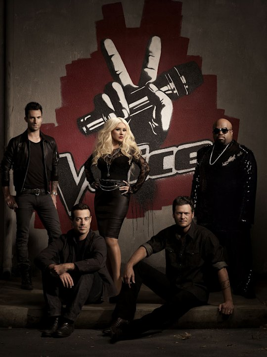 "Adam Levine, Carson Daly, Christina Aguilera, Blake Shelton, and Cee Lo Green of ""The Voice."""