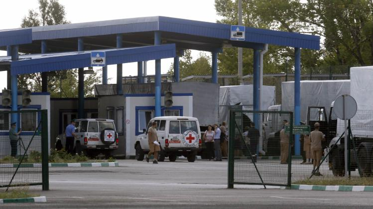 "Cars of the Red Cross and trucks of a Russian convoy carrying humanitarian aid for Ukraine are seen at a Russia-Ukraine border crossing point ""Donetsk"" during a control check in Rostov Region"