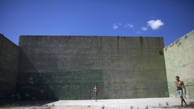 Men practice sports in the outskirts of Havana