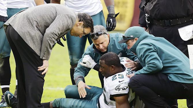 Philadelphia Eagles running back LeSean McCoy is helped up after being injured during the second half of an NFL football game against the Washington Redskins in Landover, Md., Sunday, Nov. 18, 2012. The Redskins won 31-6. (AP Photo/Alex Brandon)