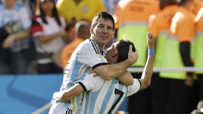 Argentina's Angel di Maria, right, and Lionel Messi celebrate after di Maria scored during the World Cup round of 16 soccer match between Argentina and Switzerland at the Itaquerao Stadium in Sao Paulo, Brazil, Tuesday, July 1, 2014