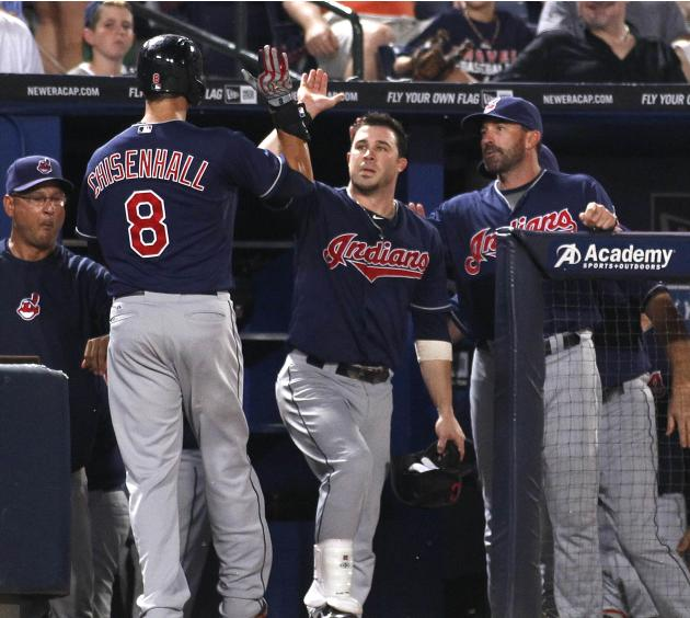Indians batter Chisenhall is congratulated at the dugout after a solo home run in the eight inning against the Atlanta Braves during their MLB inter-league baseball game in Atlanta