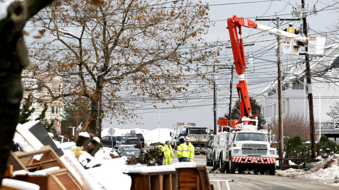 Gas rationing begins in NY; power outages persist