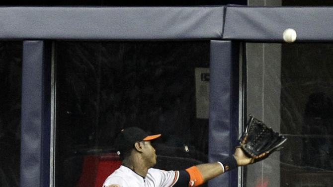 Baltimore Orioles center fielder Adam Jones chases an RBI triple by New York Yankees' Derek Jeter during the third inning in Game 3 of the American League division baseball series Wednesday, Oct. 10, 2012, in New York. (AP Photo/Kathy Willens)