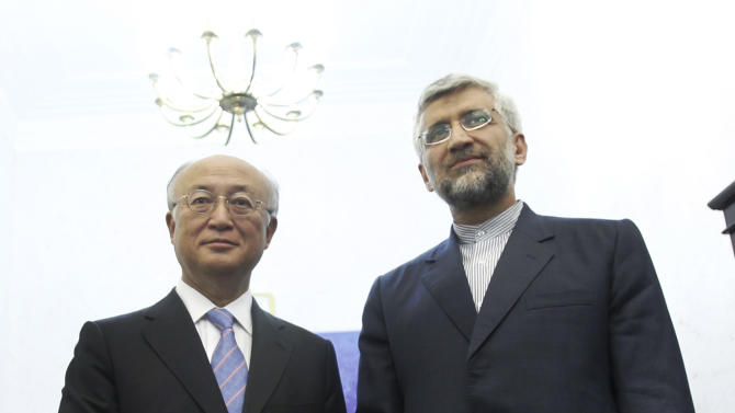 Iran's top nuclear negotiator, Saeed Jalili, right, shakes hands with International Atomic Energy Agency (IAEA) chief Yukiya Amano, at the conclusion of their meeting, in Tehran, Iran, Monday, 21, 2012. The head of the U.N. nuclear agency arrived Monday in Tehran on a key mission that could lead to the resumption of probes by the watchdog on whether Iran has secretly worked on an atomic weapon. It would also strength the Islamic Republic's negotiating hand in crucial nuclear talks with six world powers later this week in Baghdad. (AP Photo/IRNA,Adel Pazzyar)