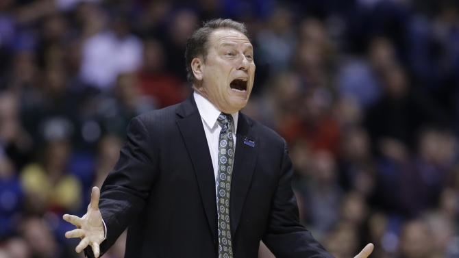 Michigan State head coach Tom Izzo reacts as he directs his team during the first half of a regional semifinal against Duke in the NCAA college basketball tournament, Friday, March 29, 2013, in Indianapolis. (AP Photo/Darron Cummings)