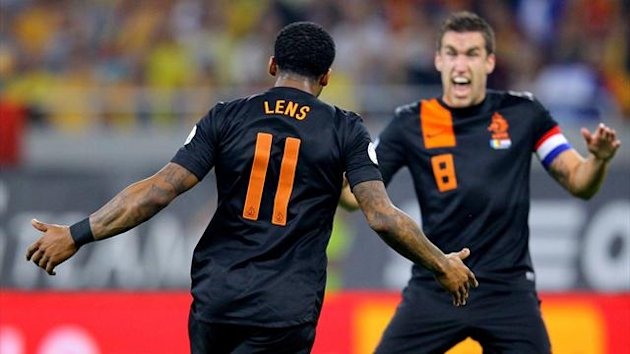 Netherlands' Jeremain Lens (L) reacts after scoring against Romania, together with his teammate Kevin Strootman (R) during the FIFA World Cup 2014 qualification match between Romania and The Netherlands, in Bucharest, Romania, 16 October 2012.