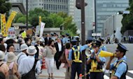 This file photo shows anti-nuclear protesters staging a demonstration outside the prime minister's official residence in Tokyo, on July 27. Weekly demonstrations outside the prime minister's residence have drawn tens of thousands of people and a rally in west Tokyo earlier this month saw a crowd that organisers claimed was about 170,000-strong