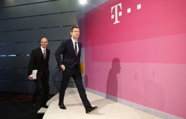 Rene Obermann, chief executive of Deutsche Telekom AG, and Timotheus Hoettges, board member for Finance of Deutsche Telekom AG, arrive for the annual news conference in Bonn