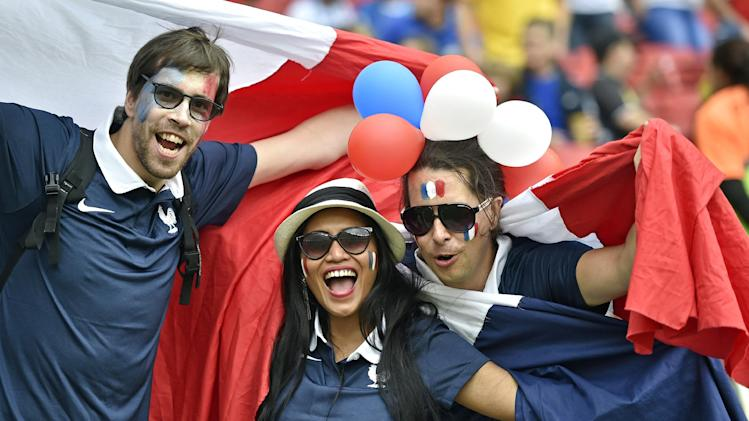 French fans cheer before the group E World Cup soccer match between France and Honduras at the Estadio Beira-Rio in Porto Alegre, Brazil, Sunday, June 15, 2014