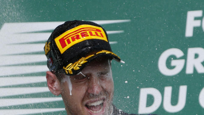 Red Bull driver Sebastian Vettel of Germany sprays champagne on the podium after winning the Formula One's Canadian Grand Prix, at the Gilles Villeneuve racetrack, in Montreal, Canada, Sunday, June 9, 2013. (AP Photo/Luca Bruno)