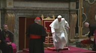 Pope Francis stumbles as he prepares to greet cardinals in Sala Clementina, at the Vatican, Friday, March 15, 2013. The newly appointed Pope Francis stumbled after being introduced to the College of Cardinals, but did not fall and quickly recovered. Cardinal Angelo Sodano, 2nd left, introduced the pope to the College of Cardinals. (AP Photo/Vatican TV) TV OUT