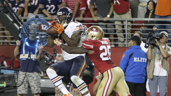 Chicago Bears wide receiver Brandon Marshall (15) catches 3-yard touchdown in front of San Francisco 49ers strong safety Jimmie Ward (25) during the fourth quarter of an NFL football game in Santa Clara, Calif., Sunday, Sept. 14, 2014