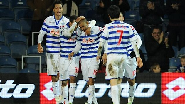 Kieron Dyer, third left, is congratulated after scoring his side's equaliser