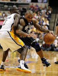INDIANAPOLIS, IN - APRIL 28: Jameer Nelson #14 of the Orlando Magic drives around the defense of Darren Collison #2 of the Indiana Pacers in Game One of the Eastern Conference Quarterfinals during the 2012 NBA Playoffs on April 28, 2012 at Bankers Life Fieldhouse in Indianapolis, Indiana. Orlando won the game 81-77 to take a 1-0 series lead. (Photo by Gregory Shamus/Getty Images)
