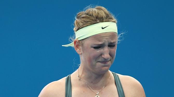 Victoria Azarenka of Belarus reacts after she missed a shot during her quarter final match against Ksenia Pervak of Kazakhstan during the Brisbane International tennis tournament held in Brisbane, Australia, Thursday, Jan 3, 2013. (AP Photo/Tertius Pickard).