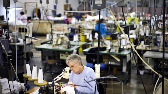 In this Monday, Oct. 15, 2012 photo, Vanessa Lagola works at her sowing machine at FesslerUSA apparel manufacture in Orwigsburg, Pa. U.S. manufacturing expanded for the second straight month in October, boosted by growth in new orders and production. The Institute for Supply Management says its index of factory activity rose last month to 51.7, up from September's reading of 51.5. A reading above 50 indicates expansion. (AP Photo/Matt Rourke, File)