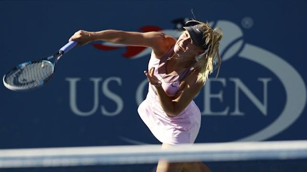 Maria Sharapova of Russia serves to Mallory Burdette of the U.S. during their women&#39;s singles match at the U.S. Open tennis tournament in New York (Reuters)