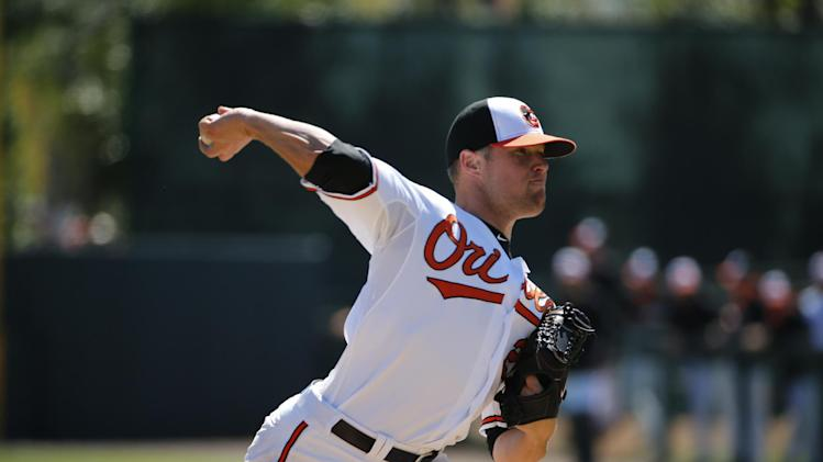 Baltimore Orioles starting pitcher Bud Norris throws during the second inning of an exhibition spring training baseball game against the Boston Red Sox in Sarasota, Fla.,Saturday, March 8, 2014. (AP Photo/Gene J. Puskar)