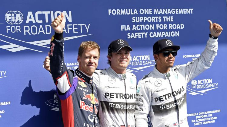 Rosberg celebrates his pole position with Hamilton and Vettel after the qualifying session at the Belgian F1 Grand Prix in Spa-Francorchamps