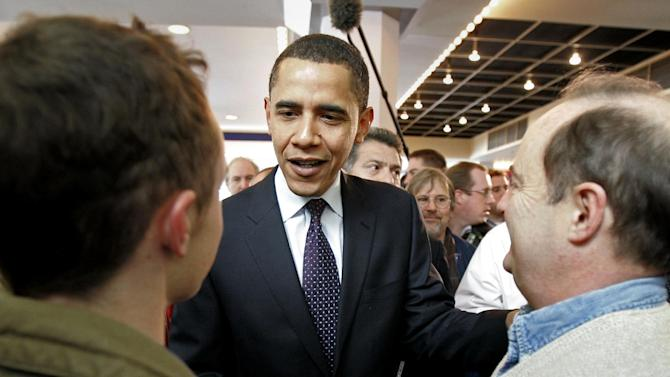 FILE - In this Jan. 3, 2008 file photo, then-Democratic presidential hopeful, Sen. Barack Obama, D-Ill., greets diners at a food court on caucus day, in Des Moines, Iowa. For President Barack Obama, it's ending where it all began. Obama will close his 2012 campaign with a nighttime rally in Iowa, where his 2008 caucus victory jumpstarted his road to the White House. The president is expected to reflect back on the state's pivotal role in his political rise during remarks delivered at the site of his first Iowa campaign headquarters. (AP Photo/M. Spencer Green, File)