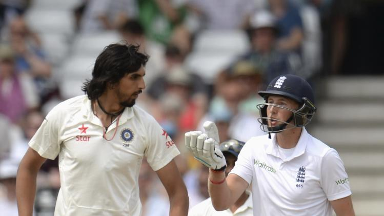 England's Root talks to India's Sharma during the first cricket test match at Trent Bridge cricket ground in Nottingham