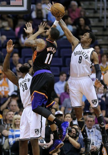 Nets escape with 102-100 victory over lowly Suns
