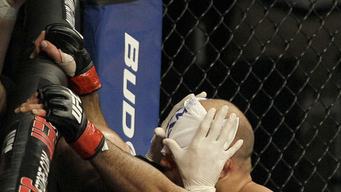 BJ Penn has his face wiped after the end of  a welterweight mixed martial arts bout against Rory MacDonald at a UFC on Fox event in Seattle, Saturday, Dec. 8, 2012. MacDonald won by unanimous decision. (AP Photo/Jeff Chiu)