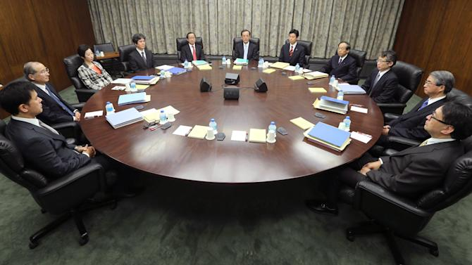 "Bank of Japan Gov. Masaaki Shirakawa, center, poses with the other members of Policy Board of the BOJ on the last day of their two-day meeting at its headquarters in Tokyo Tuesday morning, Jan. 22, 2013. Shirakawa vowed to achieve the inflation benchmark ""as soon as possible,"" in cooperation with the government Tuesday. (AP Photo/Kyodo News)  JAPAN OUT, MANDATORY CREDIT, NO LICENSING IN CHINA, HONG KONG, JAPAN, SOUTH KOREA AND FRANCE"