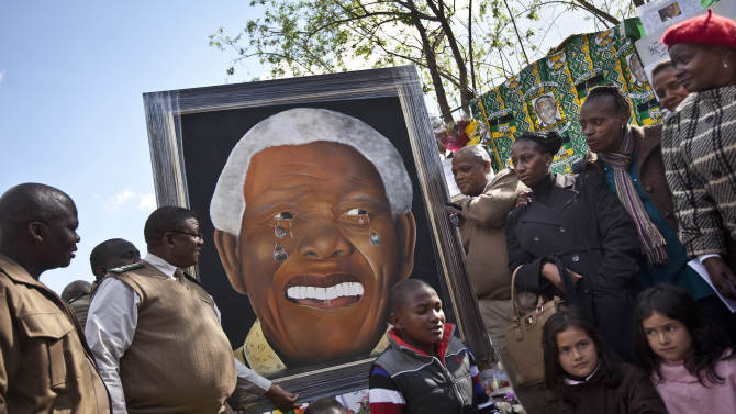 A painting of Nelson Mandela which has been in Klerksdorp prison since it was made in 2011 by a prisoner named Renato Booysen, who was later released, is donated by the prison authorities to the Mediclinic Heart Hospital where former South African President Nelson Mandela is being treated in Pretoria, South Africa Thursday, July 11, 2013. Nelson Mandela is responding to treatment and the 94-year-old's condition remains critical but stable after more than a month in the hospital, South Africa's president said Wednesday. (AP Photo/Ben Curtis)