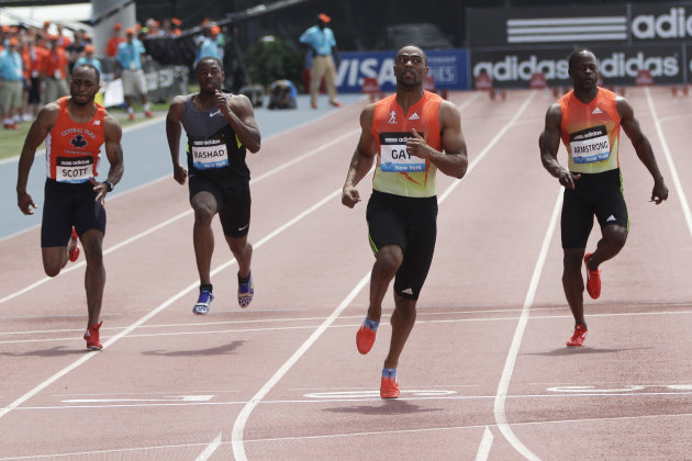 Tyson Gay, second from right, crosses the finish line ahead of the pack during the 100-meter B race at the Adidas Grand Prix track and field meet on Randall's Island, Saturday, June 9, 2012, in New Yo