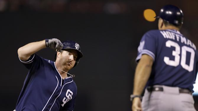 San Diego Padres' Jedd Gyorko, is congratulated by third base coach Glenn Hoffman while rounding the bases after hitting a solo home run during the seventh inning of a baseball game against the St. Louis Cardinals Friday, July 3, 2015, in St. Louis. The Padres won 2-1. (AP Photo/Jeff Roberson)