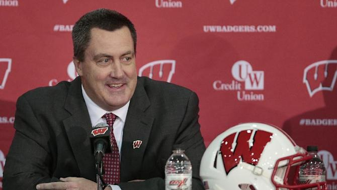 In this Dec. 17, 2014, file phtoo, Paul Chryst, Wisconsin's new football coach, speaks during an a NCAA college football news conference at the Nicholas-Johnson Pavilion in Madison, Wis. Chryst kept close tabs on recruits in Wisconsin while coaching at Pittsburgh. Now that he is back with the Badgers, Chryst seems to be reinforcing ties in his home state