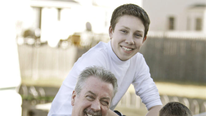 In this March 20, 2008 file photo, former Bolingbrook police officer Drew Peterson poses with his children daughter Lacy, 3, Anthony, 4, left, Christopher, 13, right, and Thomas, 15, at their home in Bolingbrook, Ill. Christopher and Thomas were from Peterson's marriage to his third wife, Kathleen Savio. Lacy and Anthony were from his marriage to fourth wife, Stacy Peterson. Stacy adopted Savio's children after Savio's death in 2004. Opening statements are slated for Tuesday, July 31, 2012, in the much-anticipated trial of Drew Peterson, who was charged with the 2004 murder of Savio, only after his 23-year-old fourth wife, Stacy Peterson, vanished without a trace in 2007. Today, there's no hint of animosity between the two families. They share not only grief but a common goal _ of seeing Drew Peterson convicted and sent away to prison for life. (AP Photo/M. Spencer Green, File)