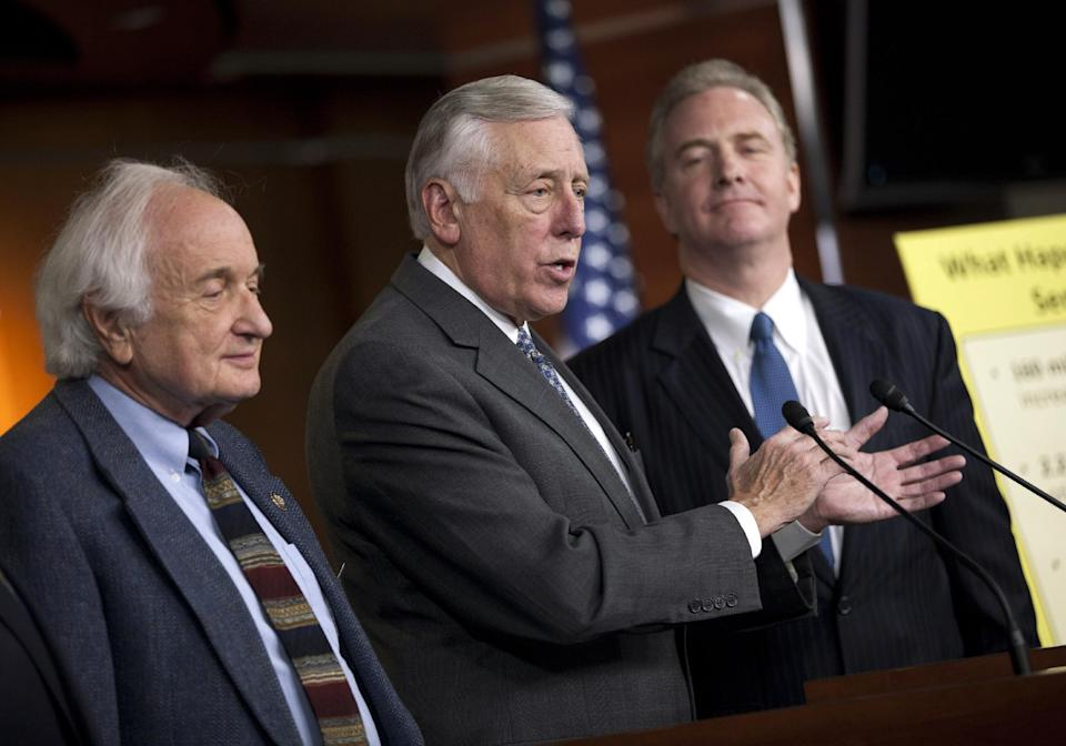 House Minority Whip Rep. Steny Hoyer, D-Md., center, Rep. Carl Levin, D-Mich., left, and Rep. Chris Van Hollen, D-Md., hold a news conference on the payroll tax cut on Capitol Hill on Thursday, Dec. 22, 2011 in Washington.  (AP Photo/Evan Vucci)