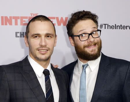 "Cast members Franco and Rogen pose during premiere of the film ""The Interview"" in Los Angeles"