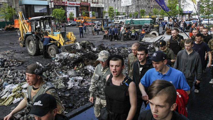 Members of Maidan self-defence forces march along the street in central Kiev