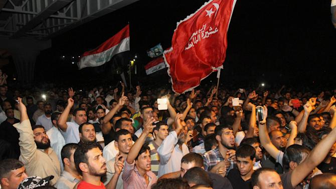 Protesters chant anti-Iraqi government slogans during a protest in Basra, Iraq's second-largest city, 550 kilometers (340 miles) southeast of Baghdad, Iraq, Wednesday, July 24, 2013. The protesters were calling on the government to provide security and better services. (AP Photo/Nabil al-Jurani)