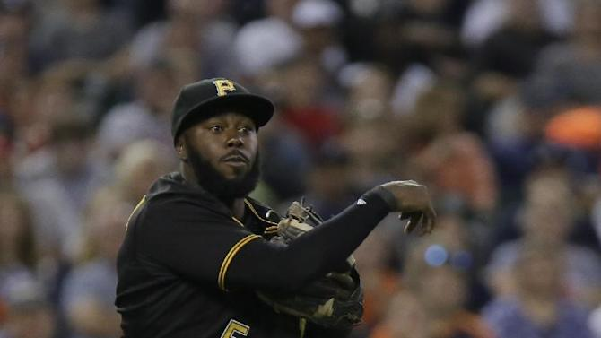 Pittsburgh Pirates third baseman Josh Harrison watches his throw to first base to make an out on Detroit Tigers' Jose Iglesias during the seventh inning of a  baseball game Wednesday, July 1, 2015, in Detroit. (AP Photo/Duane Burleson)