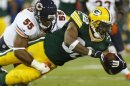 Green Bay Packers Benson is tackled by Chicago Bears Briggs during their NFL football game in Green Bay
