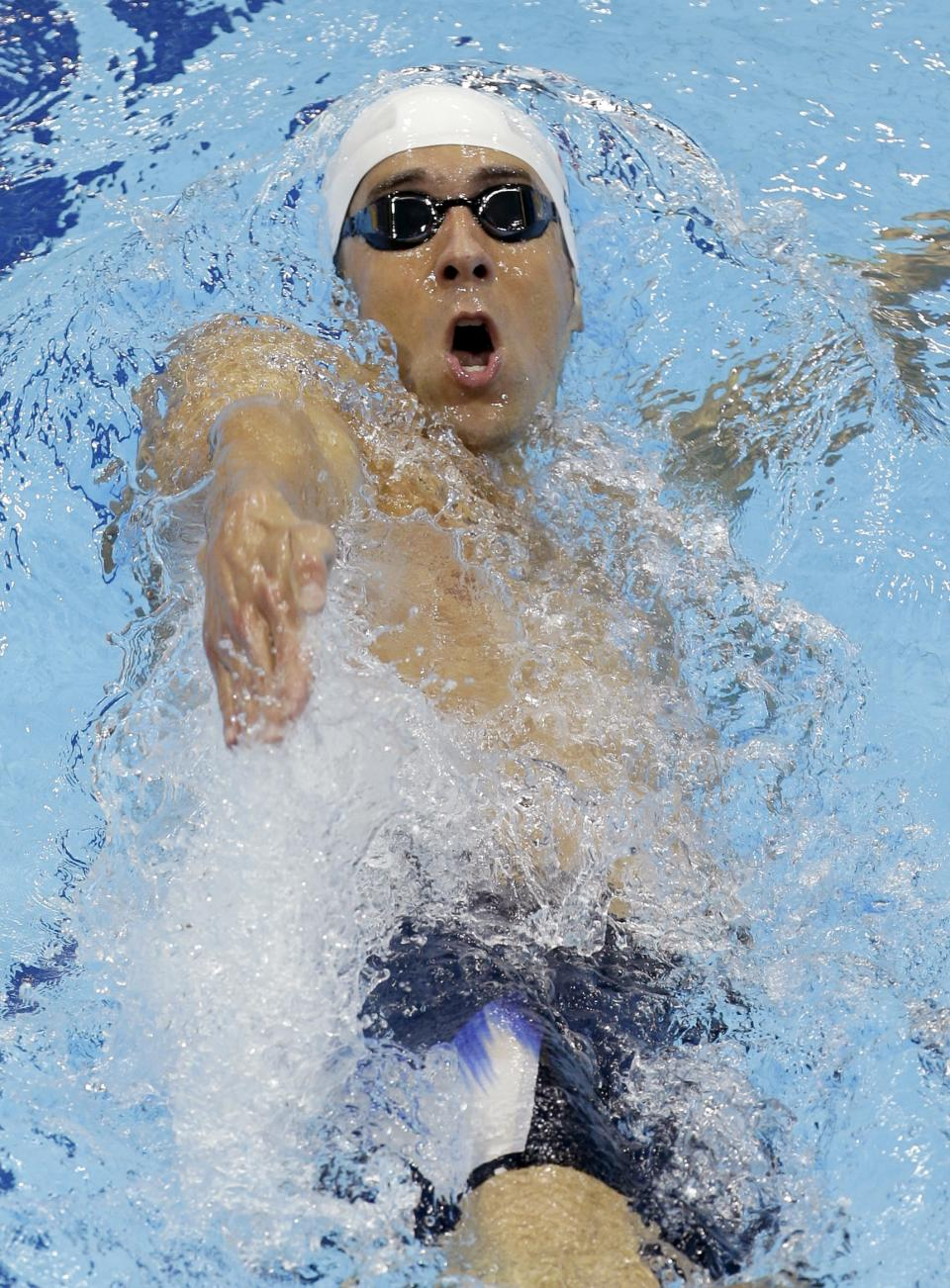 USA's Michael Phelps competes in a heat of the men's 400-meter individual medley at the Aquatics Centre in the Olympic Park during the 2012 Summer Olympics in London, Saturday, July 28, 2012. (AP Photo/Lee Jin-man)