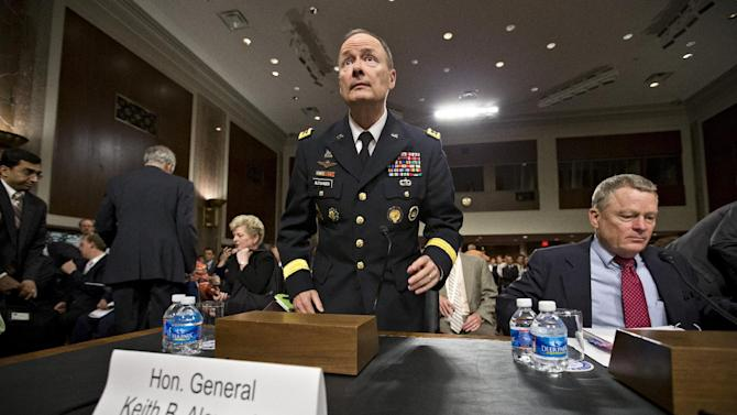 Gen. Keith B. Alexander, director of the National Security Agency and head of the U.S. Cyber Command, arrives on Capitol Hill in Washington, Wednesday, June 12, 2013, to testify before the Senate Appropriations Committee, his first public appearance since revelations that the electronic surveillance agency is sweeping up Americans' phone and Internet records in its quest to investigate terrorist threats. He is joined by Rand Beers, seated at right, the under secretary for the Department of Homeland Security. (AP Photo/J. Scott Applewhite)