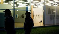 Dutch police stand guard after a break-in at the Kunsthal museum in Rotterdam. Several paintings of considerable value were stolen from Rotterdam&#39;s Kunsthal museum where works by world-renowned 19th and 20th century artists including Picasso and Van Gogh are on display