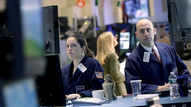Traders work on the floor at the New York Stock Exchange in New York, Monday, Dec. 31, 2012. World stocks cooled off Monday Jan. 7, 2013 as some investors sold shares to lock in profits following recent rallies.  (AP Photo/Seth Wenig)