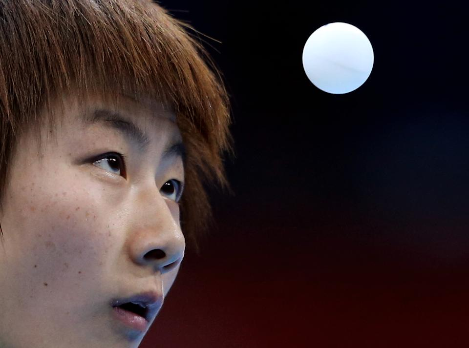 China's Ning Ding during the fourth round of women's table tennis at the 2012 Summer Olympics, Monday, July 30, 2012, in London. (AP Photo/Sergei Grits)