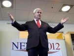 Republican presidential candidate, former House Speaker Newt Gingrich gestures during a campaign stop at Insight Technology in Londonderry, N.H. Monday, Dec. 12, 2011. (AP Photo/Elise Amendola)