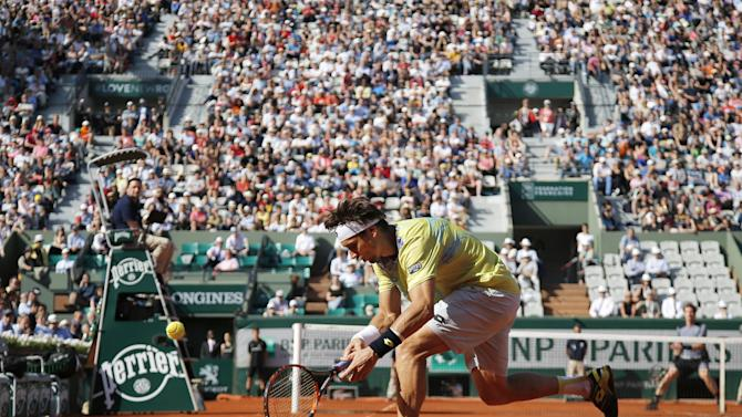 Spain's David Ferrer misses a ball as he plays Britain's Andy Murray during their quarterfinal match of the French Open tennis tournament, at the Roland Garros stadium, Wednesday, June 3, 2015 in Paris.  (AP Photo/Francois Mori)