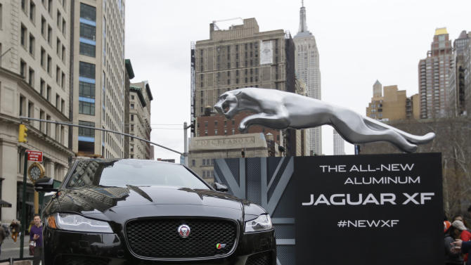 The new Jaguar all-aluminum XF sedan is presented during a unveiling event at Flat Iron Square ahead of its debut at the New York International Auto Show, Tuesday, March 31, 2015, in New York. (AP Photo/Mary Altaffer)